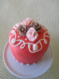 Calypso Coral Cupcake (color) with Chocolate Flavored and Peaches & Cream (color) Roses.